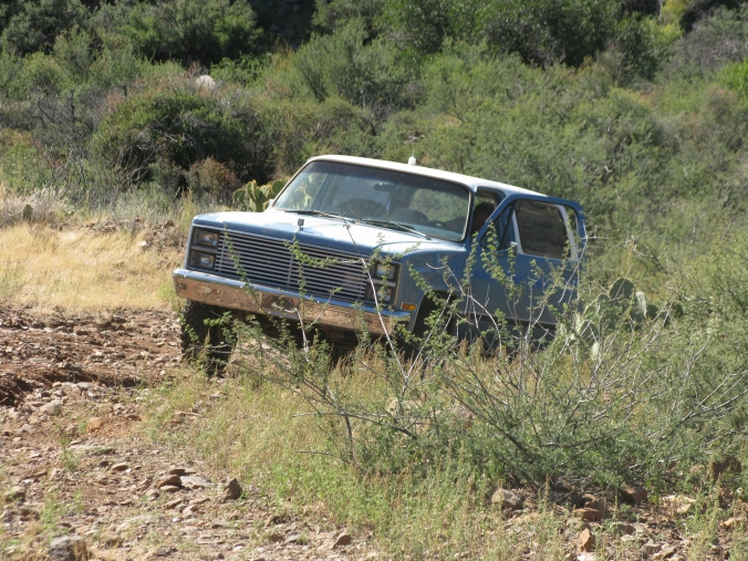 Jimmy up and out of the ditch and backing down the mountain to the wash